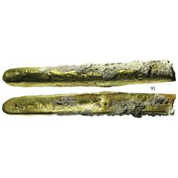 Long, coral-encrusted gold bar #43, 17¼K, one end cut, from the  Golden Fleece wreck  (ca. 1550).