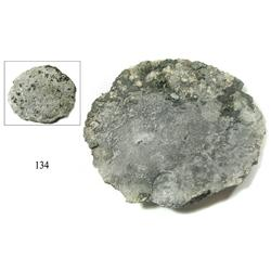 "Round silver ""splash"" ingot #19 from the ""Golden Fleece wreck"" (ca. 1550)."