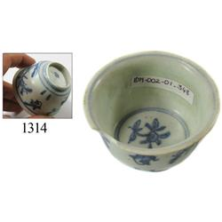 Chinese blue-on-white porcelain teacup, trees/birds design.