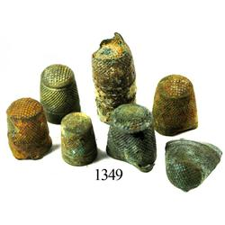 Lot of 6 brass sailmakers' thimbles and clump of several more.