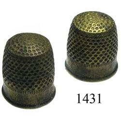 Lot of 2 small brass sailmaker's thimbles.