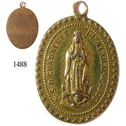 Ornate rose-gold (14K) medallion of the Virgen de la Guadalupe, dated 1805.