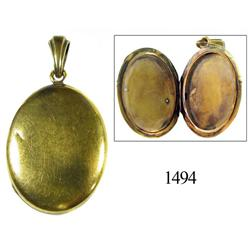 Gold oval locket.