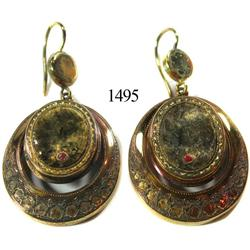 Pair of large, low-grade gold earrings.