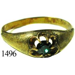 Low-grade gold ring with green stone.