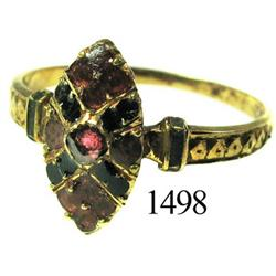 Low-grade gold ring with red stone and enamel.