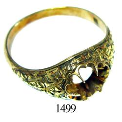 Gold ring with socket for gemstone.