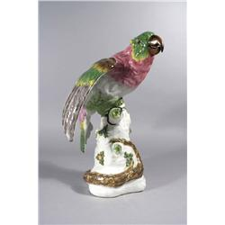 An Early 20th Century Continental Porcelain Figure of a Parrot wi