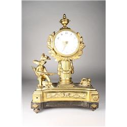 A Louis-Philippe gilt bronze mantel clock.