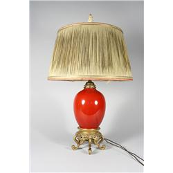 A Chinese red glazed porcelain table lamp with gilt bronze base.