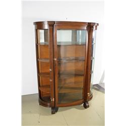 An American Empire Style Oak Curio Cabinet.