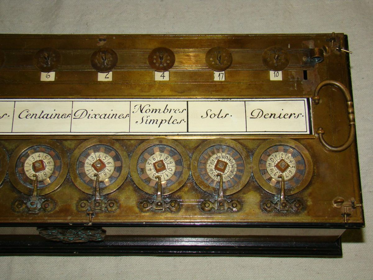 pascaline calculator in rosewood case