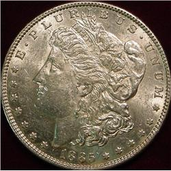 1885 P Morgan Silver Dollar. AU
