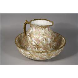 A Limoges Porcelain Wash Basin and Pitcher.