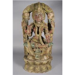 A Carved Hardwood Figure of Lakshmi, an Indian Goddess,