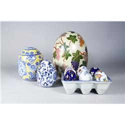 A Group of Three Porcelain Egg Forms, Together with Six Small Ceramic Eggs in a Ceramic Egg Carton.