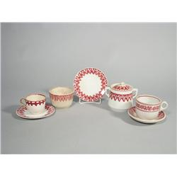 A Group of Seven Stick Spatter Soft Paste Cups, Saucers and Sugar Bowl in Red Fern Pattern.