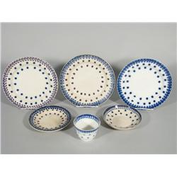 A Group of Five Stick Spatter Plates and One Custard Cup in Blue Snowflake Pattern.
