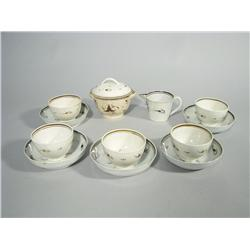 A Collection of 18th Century English Soft Paste Stick Spatter Custard Cups and Saucers Together with