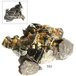 Pyramidal clump of over 30 silver cobs and pebbles.
