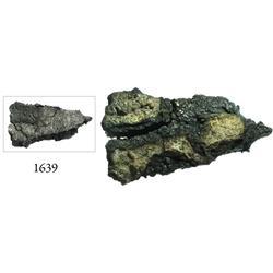"Cut piece of a silver ""splash"" ingot from an unidentified ca.-1554 wreck off Santo Domingo, 4.08 tro"