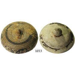 Pair of earthenware jar lids (one repaired).