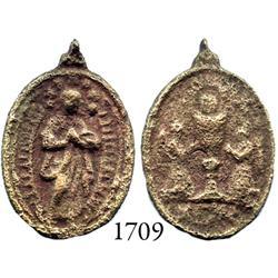 Small brass religious medallion.