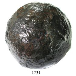 Large iron cannonball.