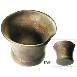 Large bronze mortar.