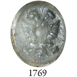 Small glass seal with two-headed eagle design.