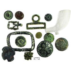 Lot of buttons, buckles and a clay pipe bowl.