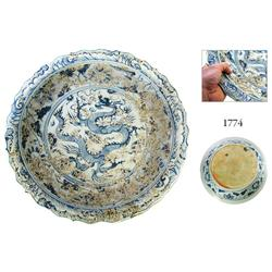 Huge, uncleaned, blue-on-white Chinese porcelain bowl with dragon motif.