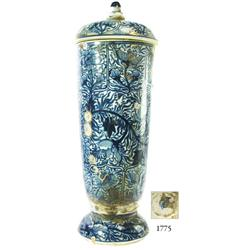 Tall, uncleaned, blue-on-white Chinese porcelain jar and lid with floral motif.