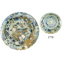 Uncleaned, blue-on-white Chinese porcelain dish with water-bird motif.