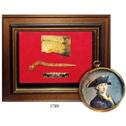 Nail and wood from the ship in a shadow box accompanied by a miniature print of Nelson.