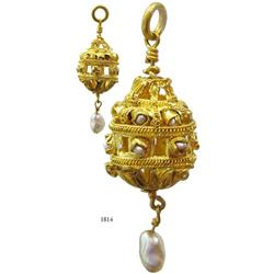 Large gold filigree earring with pearl.