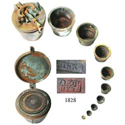 Very rare complete set of bronze nested weights with lid and case.