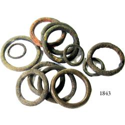 Lot of 12 bronze equestrian bridle rings of various sizes.