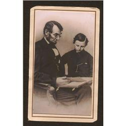 Abraham Lincoln photo with young man leafing through a book