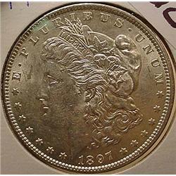 1897-P MORGAN SILVER DOLLAR - UNC.