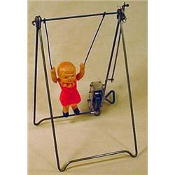 VINTAGE CELLULOID WIND-UP TOY - GIRL ON TRAPEZE