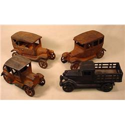 LOT OF 4 CAST IRON CARS - 3 have rust and 1 appear