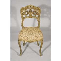 A Louis XV French Rococo Carved and Gilt Side Chair.