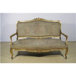A Louis XV Canapé with Arched Padded Back and Bowed Seat Covered in Petit Point Needlework in Moulde