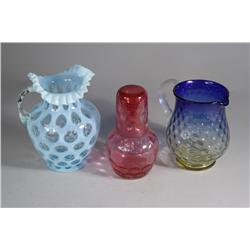 A Cranberry Glass Tumble Up, Together with Two Victorian Colored Glass Blown Pitchers.