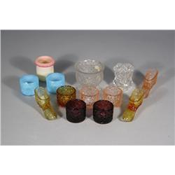 A Collection of Thirteen Pressed Colored Glass Toothpick Holders.