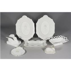 A Collection of Seven Pieces of Milk Glass.