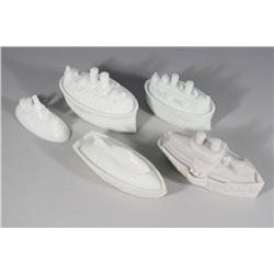 A Collection of Five Pieces of Pressed Milk Glass Depicting Battle Ships.