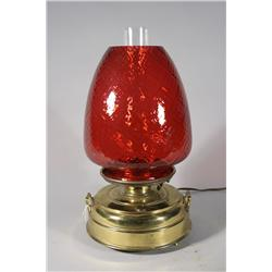 An Electrified Cranberry Glass and Brass Oil Lamp.