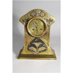 A Waterbury Arts and Crafts Brass Clock.